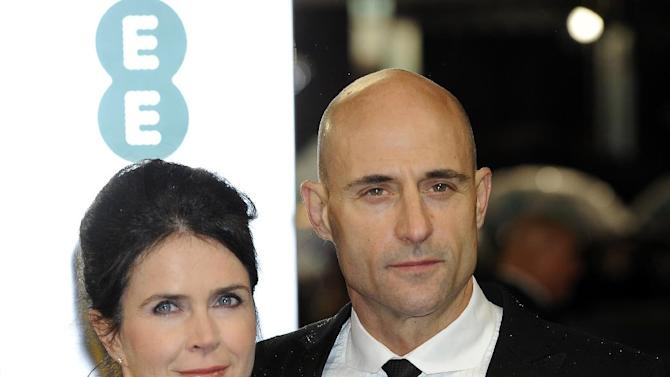 Liza Marshall, left, and British actor, Mark Strong arrive for the BAFTA Film Awards at the Royal Opera House on Sunday, Feb. 10, 2013, in London. (Photo by Jonathan Short/Invision/AP)
