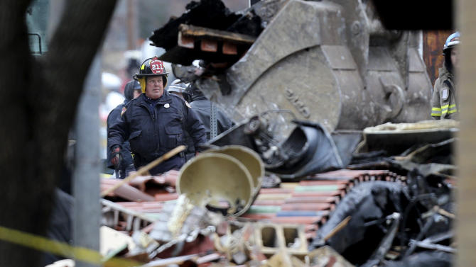 A Kansas City Missouri firefighters walks through the rubble of JJ's restaurant after an explosion and fire tore through the establishment Tuesday evening near the Country Club Plaza Wednesday, Feb. 20, 2013, in Kansas City, Mo. One person was killed and injuring over a dozen. (AP Photo/Ed Zurga)