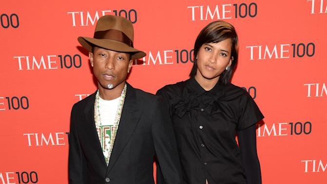 Pharrell Williams, left, and Helen Lasichanh arrive at 2014 TIME 100 Gala held at Frederick P. Rose Hall, Jazz at Lincoln Center, on Tuesday, April 29, 2014, in New York. (Photo by Evan Agostini/Invision/AP)
