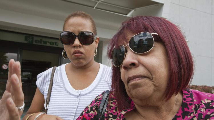 Coco, widow of Puerto Rican singer Jose 'Cheo' Feliciano, talks to journalists outside the funeral home where her husband's body lies in San Juan