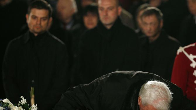 Relative touches the body of former Bulgarian President Zhelev during his funeral service in Alexander Nevski cathedral in Sofia