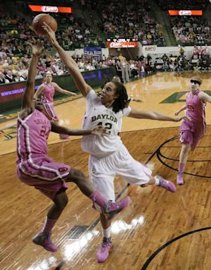 Baylor 's Brittney Griner (42) blocks a shot attempt by Oklahoma 's Sharane Campbell (24) in the first half of an NCAA women's college basketball game Monday, Feb. 6, 2012, in Waco, Texas. (AP Photo/Tony Gutierrez)