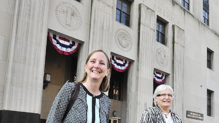 Married couple Glenna DeJong, left, and Marsha Caspar during a rally outside the U.S. District Court before the start of a motion hearing in the lawsuit the ACLU filed against State of Michigan concerning legalized same sex marriages, in Detroit, Michigan on Thursday, Aug. 21, 2014. Advocates for gay marriage asked a federal judge Thursday to legally recognize the 300 marriages of same-sex couples in Michigan on March 22, the day after a historic ruling overturned the state's ban on same-sex marriage. (AP Photo/Detroit News, Daniel Mears) DETROIT FREE PRESS OUT; HUFFINGTON POST OUT