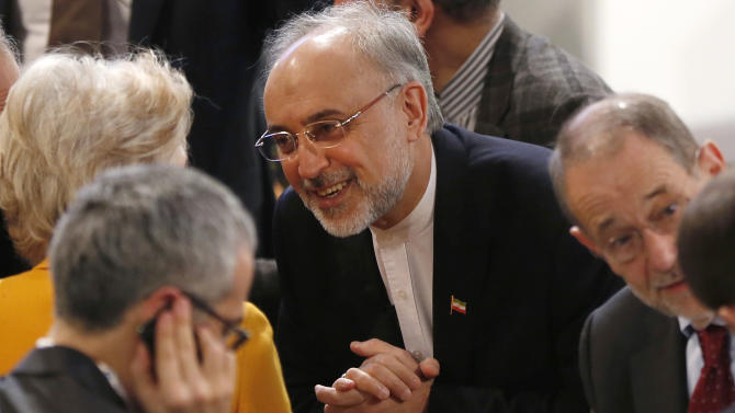 Iranian Foreign Minister Ali Akbar Salehi, center, arrives for the Security Conference in Munich, Germany, on Sunday, Feb. 3, 2013. The 49th Munich Security Conference started Friday afternoon until Sunday attended by experts from 90 delegations. (AP Photo/Matthias Schrader)