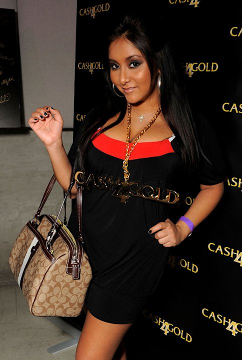 Nicole 'Snooki' Polizzi poses at the Kari Feinstein Golden Globes Style Lounge at Zune LA on January 14, 2010 in Los Angeles, California.
