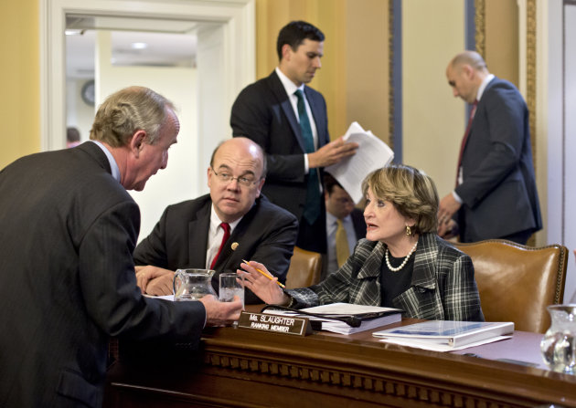 <p>               Rep. Rodney Frelinghuysen, R-N.J., left, confers with Rep. Louise Slaughter, D-N.Y., Rep. Jim McGovern, D-Mass., center, as the House Rules Committee sorts through dozens of amendments on an aid package to assist victims of Superstorm Sandy that devastated parts of the Northeast coast in October, at the Capitol in Washington, Monday, Jan. 14, 2013. The House is expected to vote on the bill Tuesday. (AP Photo/J. Scott Applewhite)