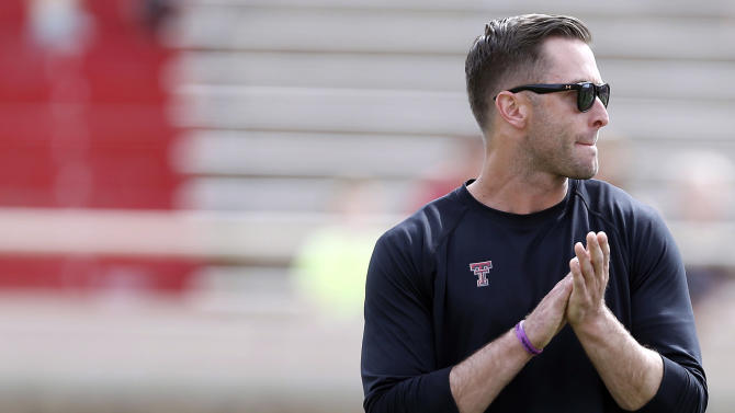 Texas Tech coach Kliff Kingsbury stands during a spring NCAA college football game Saturday, April 12, 2014, in Lubbock, Texas