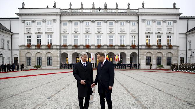 Belgium's King Philippe and Poland's President Andrzej Duda meet during an official welcoming ceremony at the courtyard in the front of the Presidential Palace in Warsaw