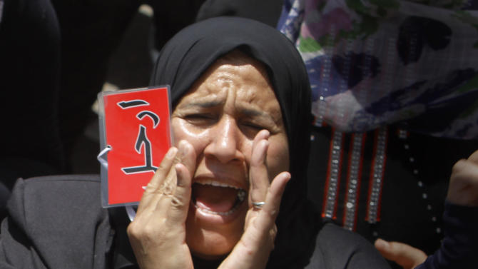 "An Egyptian protester shouts anti-President Mohammed Morsi slogans during a protest in Tahrir Square, the focal point of Egyptian uprising, in Cairo, Egypt, Friday, June 28, 2013. Arabic reads, ""down with Muslim brotherhood rule, June 30 in front of the presidential palace."" Thousands of backers of Egypt's Islamist president rallied Friday in Cairo in a show of support ahead of planned opposition protests this weekend demanding his removal, as passengers swamped the capital's international airport to leave, fearing widespread violence. The opposition plans to bring out massive crowds on Sunday in protests nationwide, vowing to force President Mohammed Morsi to step down. Across the city from the pro-Morsi rally Friday, thousands massed in Cairo's central Tahrir Square, shouting for the president to ""leave, leave,"" (AP Photo/Amr Nabil)"