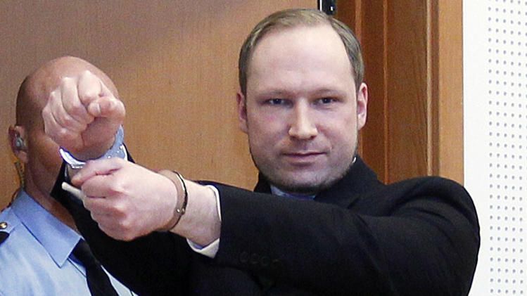 FILE -  In this Feb. 6, 2012 file photo, Anders Behring Breivik, a right-wing extremist who confessed to a bombing and mass shooting that killed 77 people on July 22, 2011, gestures as he arrives for a detention hearing at a court in Oslo, Norway. Breivik is not criminally insane, a psychiatric assessment found Tuesday, April 10, 2012 contradicting an earlier assessment. The new conclusion comes just six days before Breivik is scheduled to go on trial on terror charges for the massacre on July 22. (AP Photo/Heiko Junge, Scanpix Norway, File) NORWAY OUT