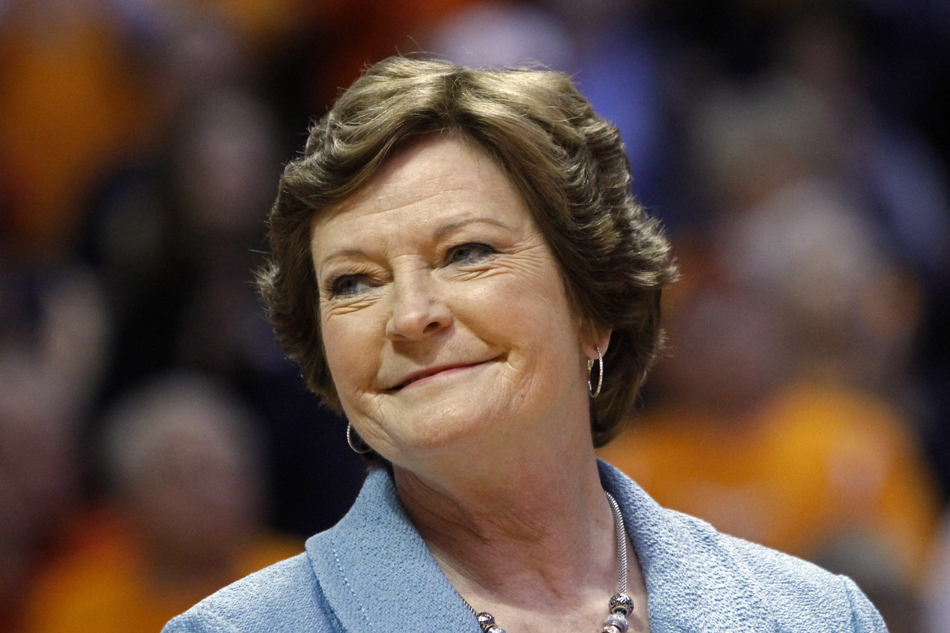 Family, friends and former players at coach Pat Summitt's side