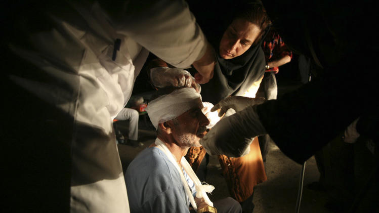 Medics treat an injured man after an earthquake in the city of Varzaqan in northwestern Iran, on Saturday, Aug. 11, 2012. A 6.2-magnitude earthquake hit the towns of Ahar, Haris and Varzaqan in East Azerbaijan province in northwestern Iran on Saturday, state TV said. Iran is located on seismic fault lines and is prone to earthquakes. It experiences at least one earthquake every day on average, although the vast majority are so small they go unnoticed. (AP Photo/Mehr News Agency, Ali Hamed Haghdoust)