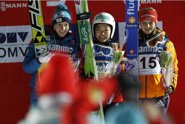 Winner Takanashi of Japan, shared second placed Austria's Iraschko-Stolz and Ernst of Germany on the podium after the FIS World Cup ski jumping HS100 in Lillehammer