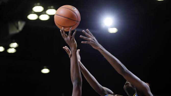 From left, Stanford 's Chiney Ogwumike (13) battles for a rebound against California 's Layshia Clarendon (23), Talia Caldwell (33) and Gennifer Brandon (25) during the first half of an NCAA college basketball game in Stanford, Calif., Sunday, Jan. 13, 2013. (AP Photo/Marcio Jose Sanchez)