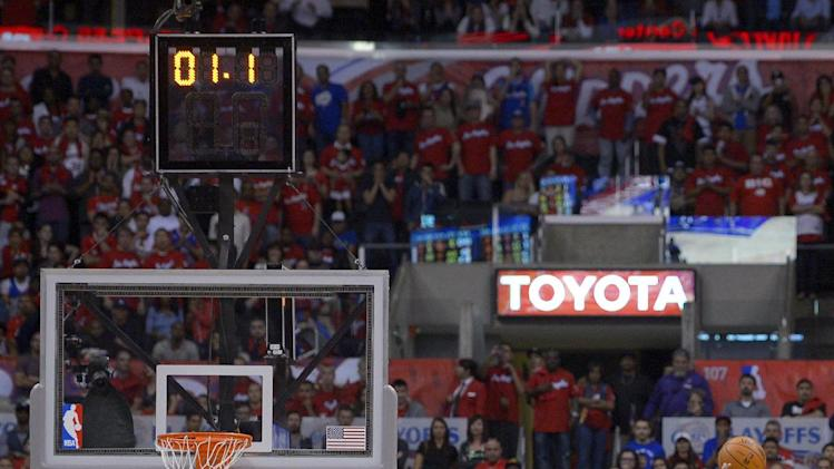 Los Angeles Clippers guard Chris Paul, right, scores the game winning basket over Darrell Arthur and Tony Allen during the second half of Game 2 of a first-round NBA basketball playoff series, Monday, April 22, 2013, in Los Angeles.  (AP Photo/Mark J. Terrill)