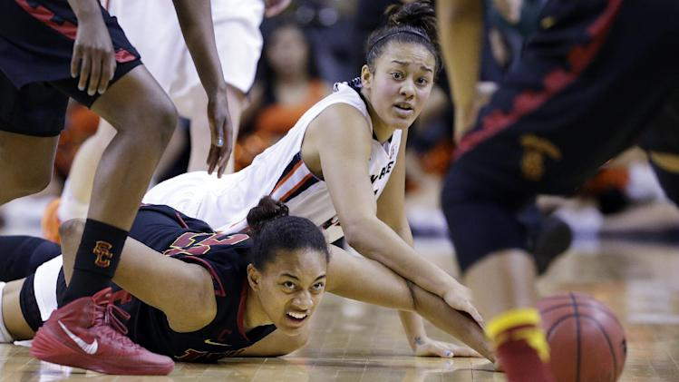 Southern California's Alexyz Vaioletama, left, and Oregon State's Deven Hunter eye a loose ball in the second half of the Pac-12 NCAA college championship basketball game Sunday, March 9, 2014, in Seattle. USC won 71-62. (AP Photo/Elaine Thompson)