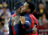 USA's Lebron James, left, and USA's Andre Iguodala, right, celebrate during a preliminary men's basketball game against Lithuania at the 2012 Summer Olympics, Saturday, Aug. 4, 2012, in London. (AP Photo/Eric Gay)