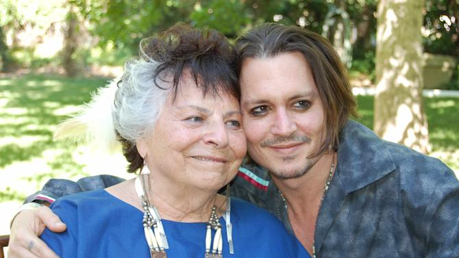 "This photo provided by Americans for Indian Opportunity shows LaDonna Harris, left, president of Americans for Indian Opportunity, poses with actor Johnny Depp at her Albuquerque, N.M., home on May 16, 2012. Harris invited Depp to become an adopted member of the Comanche Indian tribe in a private ceremony. Depp is currently filming the role of Tonto in ""The Long Ranger"" in New Mexico. (AP Photo/Courtesy of Americans for Indian Opportunity)"
