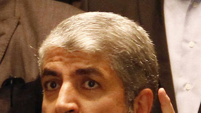 Hamas leader Khaled Mashaal gestures during a press conference in Cairo, Egypt, Wednesday, Nov. 21, 2012 after a cease-fire between Hamas and Israel. Israel and the Hamas militant group agreed to a cease-fire Wednesday to end eight days of the fiercest fighting in nearly four years, promising to halt air strikes and rocket attacks that have killed scores and to discuss easing an Israeli blockade constricting the Gaza Strip. Mashaal said the deal included an agreement to open all border crossings with the Gaza Strip, including the important Rafah crossing with Egypt. A copy of the deal obtained by The Associated Press appeared to be somewhat vague about the details on the crossings. (AP Photo/Ahmed Abd el Fatah)