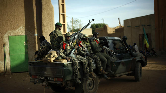 Malian  soldiers patrol the streets of  Gao, northern Mali, Tuesday Feb. 5, 2013.  Troops from France and Chad moved into Kidal in an effort to secure the strategic north Malian city, a French official said Tuesday, as the international force put further pressure on the Islamic extremists to push them out of their last major bastion of control in the north.(AP Photo/Jerome Delay)