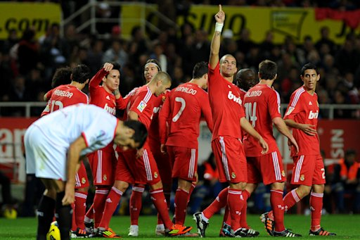 Real Madrid's players celebrate a goal during their Spanish league football match Sevilla FC vs Real Madrid on December 17, 2011 at Ramon Sanchez Pizjuan stadium in Sevilla. Real Madrid won 6-2. AFP PHOTO/ JORGE GUERRERO (Photo credit should read Jorge Guerrero/AFP/Getty Images)