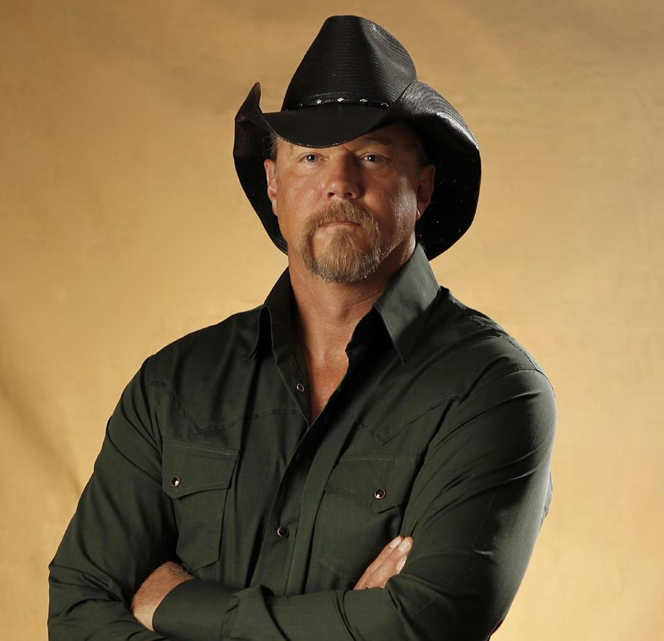 FILE - This Aug. 4, 2010 file photo shows country singer Trace Adkins in Nashville, Tenn. American Country Awards announced Tuesday, Aug. 28, 2012 that country star Trace Adkins and entertainer Kristin Chenoweth are returning as hosts of the 3rd American Country Awards. (AP Photo/Mark Humphrey, File)