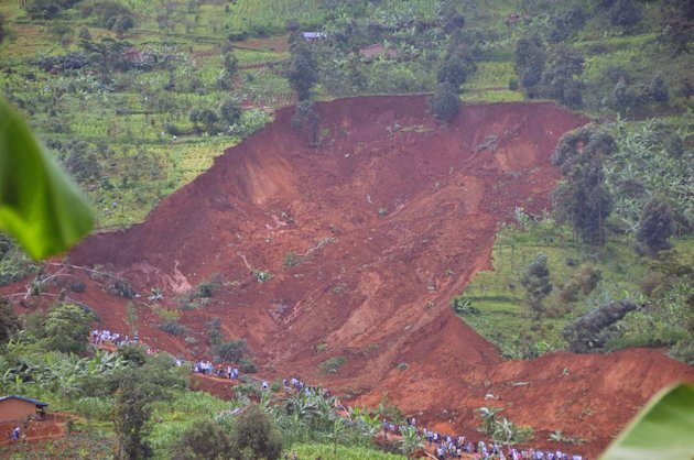 An arial view of the scene of the landslide of the Bududa about 250kms east of Uganda capital Kampala, Tuesday, June 26, 2012. Massive landslides induced by torrential rains destroyed three villages in the mountainous district of Bududa in eastern Uganda Monday, killing scores of people but possibly hundreds, officials said. (AP Photo / Stephen Wandera)