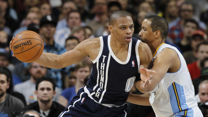 Oklahoma City Thunder guard Russell Westbrook, left, works ball inside for a shot against Denver Nuggets guard Andre Miller in the fourth quarter of the Nuggets' 105-103 victory in an NBA basketball game in Denver on Friday, March 1, 2013. (AP Photo/David Zalubowski)
