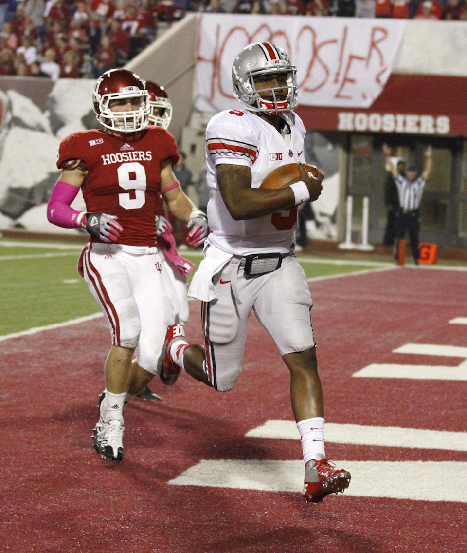 Ohio State quarterback Braxton Miller (5) scores on a 67-yard against Indiana cornerback Greg Heban (9) during the second half of an NCAA college football game in Bloomington, Ind., Saturday, Oct. 13, 2012. Ohio State won 52-49. (AP Photo/Sam Riche)