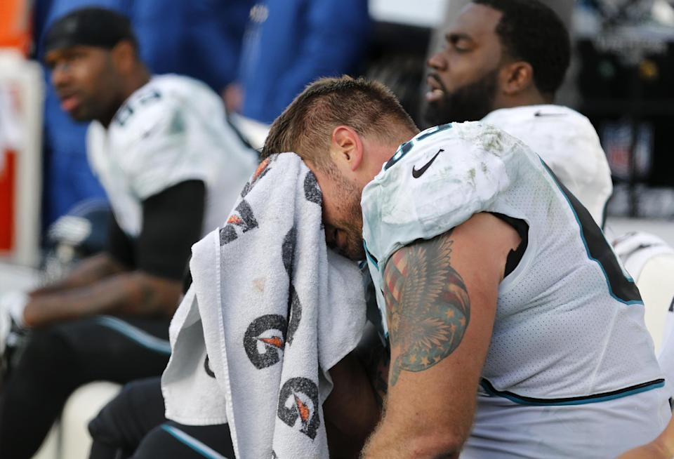Jacksonville Jaguars center Brad Meester, front, sits on the bench late in the fourth quarter of an NFL football game against the Tennessee Titans, Sunday, Dec. 30, 2012, in Nashville, Tenn. The Titans won 38-20. (AP Photo/Joe Howell)