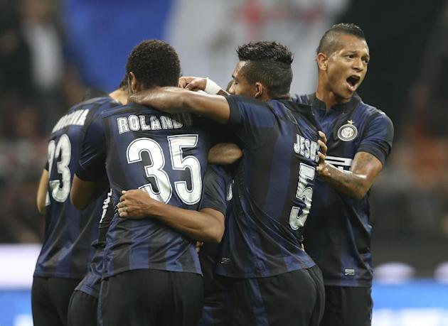 Inter Milan Brazilian defender Cicero Jonathan, covered by his teammates, celebrates after scoring during the Serie A soccer match between Inter Milan and Hellas Verona at the San Siro stadium in Mila