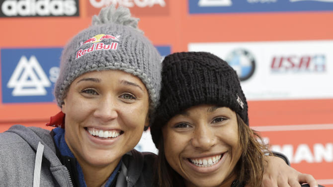 USA's pilot Jazmine Fenlator, right, and brakewoman Lolo Jones pose for photographers after their second-place finish in the women's bobsled World Cup competition on Friday, Nov. 9, 2012, in Lake Placid, N.Y. (AP Photo/Mike Groll)