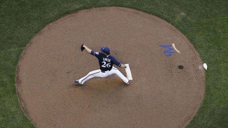 Milwaukee Brewers starting pitcher Kyle Lohse throws during the first inning of a baseball game against the Cincinnati Reds Wednesday, July 23, 2014, in Milwaukee. (AP Photo/Morry Gash)