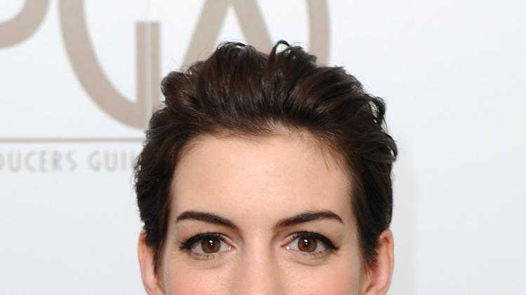 Anne Hathaway is seen backstage at the 24th Annual Producers Guild (PGA) Awards at the Beverly Hilton Hotel on Saturday Jan. 26, 2013, in Beverly Hills, Calif. (Photo by Jordan Strauss/Invision for Producers Guild/AP Images)
