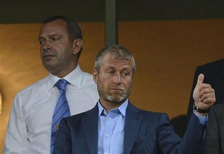 Russian billionaire and owner of Chelsea football club Roman Abramovich gives a thumbs-up before the Group D Euro 2012 soccer match between Ukraine and England at Donbass Arena in Donetsk June 19, 201