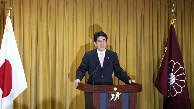 In this Monday, Dec. 17, 2012 photo, Japan's Liberal Democratic Party President Shinzo Abe speaks during a press conference at the party headquarters in Tokyo Monday, Dec. 17, 2012, a day after his conservative party's landslide victory over the ruling Democratic Party of Japan in parliamentary elections. Japan's military is kept on a very short leash under a war-renouncing constitution written by U.S. officials whose main concern was keeping Japan from rearming soon after World War II. But if Japan's soon-to-be prime minister Abe has his way, the status quo may be in for some change. (AP Photo/Koji Sasahara)