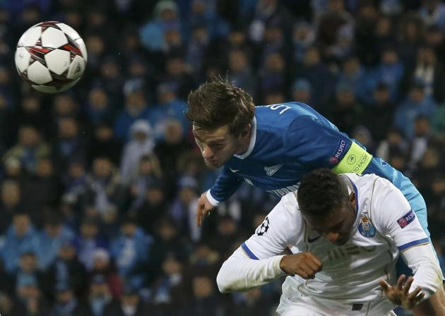 Zenit St Petersburg's Nicolas Lombaerts goes for a header with Porto's Danilo during their Champions League soccer match at the Petrovsky stadium in St. Petersburg