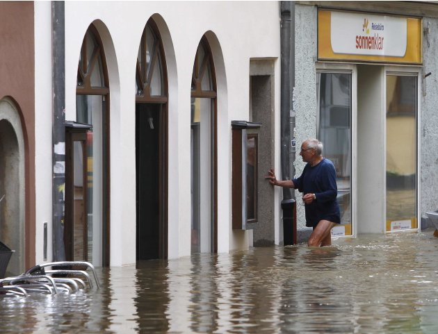 Man walks through flooded street in the centre of Passau