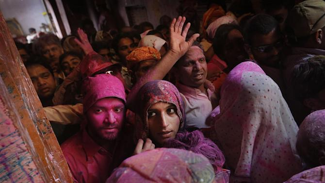 Hindu devotees crowd the entrance as they push to get inside Banke Bihari temple, dedicated to Lord Krishna, during Holi festival celebrations in Vrindavan, India, Tuesday, March 26, 2013. Holi, the festival of colors celebrates the arrival of spring. (AP Photo/Kevin Frayer)