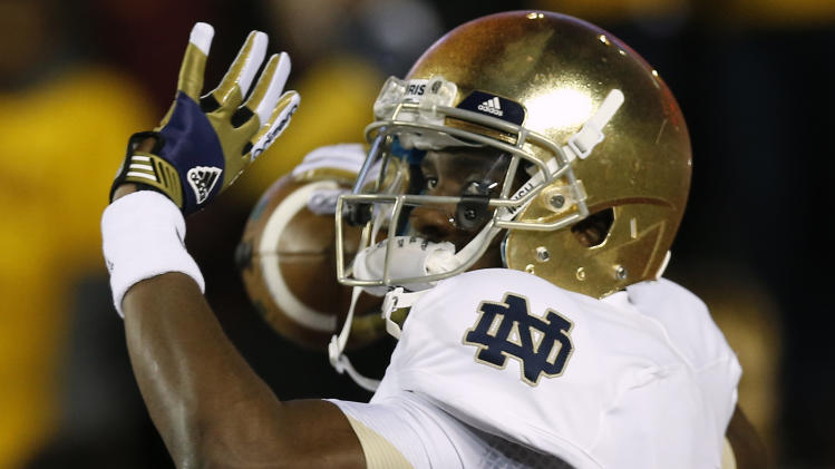 Notre Dame quarterback Everett Golson throws prior to their NCAA college football game against Boston College in Boston Saturday, Nov. 10, 2012. (AP Photo/Winslow Townson)