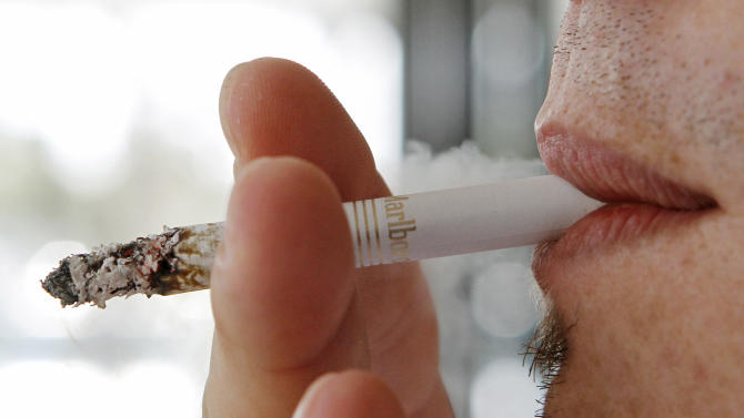Justices let stand $70M in awards to smokers