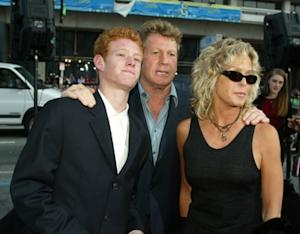 Ryan O'Neal and Farrah Fawcett arrive with their son Redmond at the premiere of 'Malibu's Most Wanted' at the Chinese Theater on April 10, 2003 in Los Angeles, California -- Getty Images