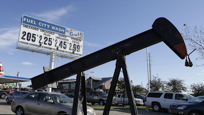 FILE - In this Dec. 15, 2014 file photo, vehicles line up to take advantage of low gas prices at the Fuel City gas station in Dallas. The collapse of oil prices this year has become a huge topic of worry and comfort for investors. (AP Photo/LM Otero, File)