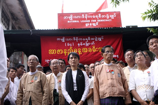 Myanmar democracy icon Aung San Suu Kyi, center, and members of her National League for Democracy party pay tribute to the independence heroes of Myanmar, during Martyr's Day ceremonies held outside t
