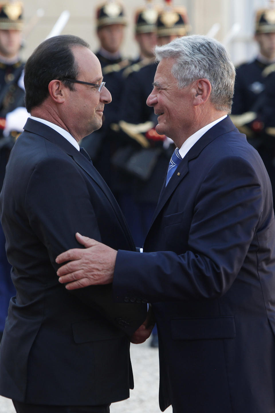 France's President Francois Hollande, left, hugs German President Joachim Gauck, prior to their talks at the Elysee Palace, in Paris, Tuesday, Sept. 3, 2013. The German head of state is in France for a three-day state visit. (AP Photo/Thibault Camus)