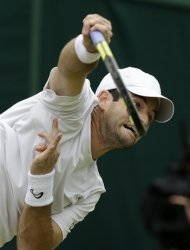 Brian Baker of the United States serves to Philipp Kohlschreiber of Germany during a fourth round singles match at the All England Lawn Tennis Championships at Wimbledon, England, Tuesday, July 3, 2012. (AP Photo/Alastair Grant)