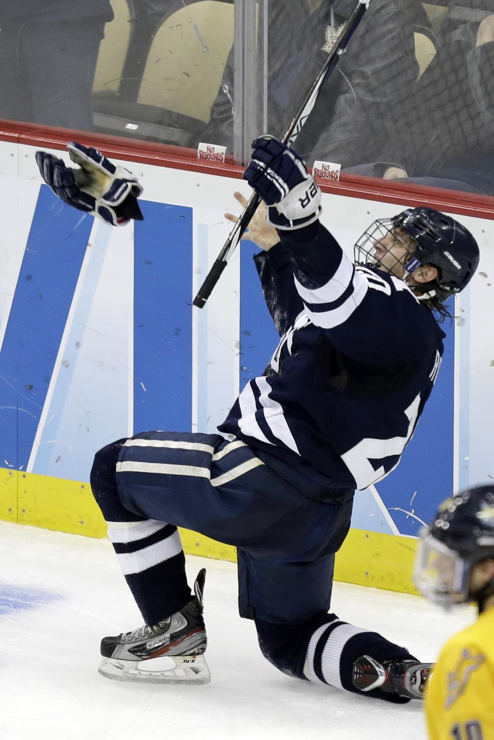 Yale's Jesse Root (20) celebrates his empty-net goal in the third period of the NCAA men's college hockey national championship game in Pittsburgh, Saturday, April 13, 2013. Yale defeated Quinnipiac 4-0. (AP Photo/Gene J. Puskar)