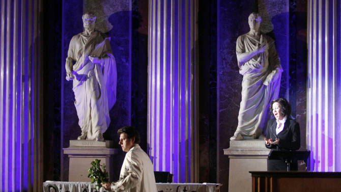 TO GO WITH HOLOCAUST OPERA STORY BY GEORGE JAHN -   Robert Holzer and Katerina Beranova, from left, perform during the holocaust opera  'Spiegelgrund ' by Austrian composer Peter Androsch in the imperial council hall of the Austrian parliament in Vienna, Friday, Jan. 25, 2013. Androsch goes where few others have dared, with an opera depicting how Nazis methodically killed mentally or physically deficient children. The performance premieres to mark International Holocaust Day in the parliament of Austria, a nation still atoning for its role in atrocities committed by the Nazis.  (AP Photo/Ronald Zak)