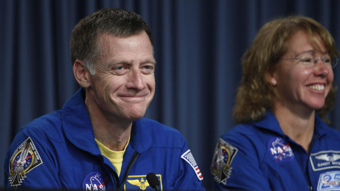 STS-135 commander Chris Ferguson, left, and mission specialist Sandra Magnus, smile during a post landing news conference at the Kennedy Space Center at Cape Canaveral, Fla. Thursday, July 21, 2011. The landing of space shuttle Atlantis marks the end of NASA's  30 year space shuttle program.  (AP Photo/J. Pat Carter)