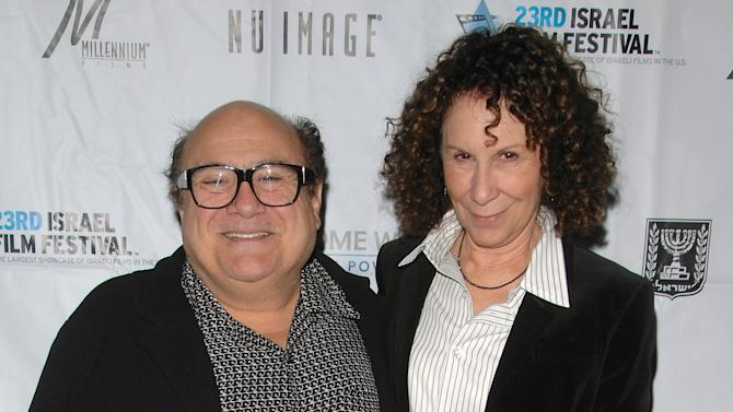 """FILE - This Oct. 29, 2008 file photo shows actors Danny Devito, left, and Rhea Perlman attending the opening night of the 23rd Annual Israel Film Festival at the Ziegfeld Theatre in New York. A spokesman for DeVito says the couple is separating after 30 years of marriage. Publicist Stan Rosenfield offered no other details. DeVito and Perlman married in 1982 and have three adult children. Together, the couple established the production company Jersey Films, which counts """"Pulp Fiction,"""" """"Erin Brockovich"""" and """"Out of Sight"""" among its credits. DeVito stars in TV's """"It's Always Sunny in Philadelphia."""" Perlman is best known for her long-running role as Carla the waitress on """"Cheers."""" (AP Photo/Peter Kramer, file)"""